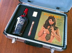 A Gift for the Man Who Has Everything! A bottle of his favorite booze, a cigar and lighter, and a Playboy magazine from the year and month he was born!
