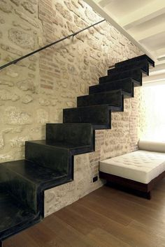 Stone wall and black stairs Staircase Railings, Stairways, Architecture Details, Interior Architecture, Murs Beiges, Deco Cafe, Brick And Stone, Stone Walls, White Stone