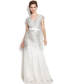I know this isn't exactly what you had in mind but it can actually be found in stores.   Adrianna Papell Cap-Sleeve Sequined Gown
