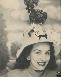 ** Vintage Photo Booth Picture **   Classic 50's beauty although I think she might have a monkey on that fashionable hat of hers.