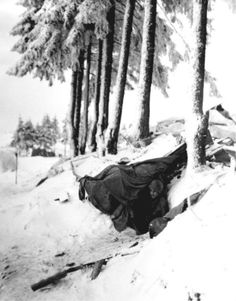 Sergeant John Opanowaki of the 101st Airborne Division, emerges from a dug-out built under snow in the Bastogne area. The 10th Armoured Division and the 101st Airborne Division were pinned down in the Bastogne area by General von Manteuffel's crack Panzer Divisions - the 2nd and the 116th.