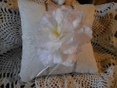 Check out this item in my Etsy shop https://www.etsy.com/listing/197547073/ring-bearer-pillow-white-with-swirls
