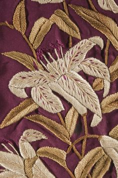 Made in Yokohama, Japan (for the Western market) it is silk plain weave (faille) dressing gown, w/astonishing silk embroidery & tasseled belt, c. 1885. Detail of embroidery. @LACMA