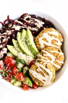 These easy vegetarian falafel bowls are served with roasted beet noodles, a cucumber-tomato salad and simple baked falafel patties. Healthy and delicious!