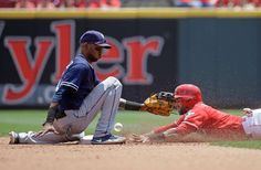 Dropped ball:    San Diego Padres shortstop Alexei Ramirez, left, misses the throw as Jose Peraza of the Cincinnati Reds steals second base in the fourth inning at Great American Ball Park in Cincinnati on June 26. The Reds won 3-0.