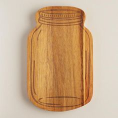 Our mason jar-shaped cutting board features a laser-etched design that brings its vintage canning jar details into sharp relief, making it perfect for serving cheese and charcuterie. Available at Cost Plus World Market >> #WorldMarket Kitchen Accessories, Mason Jars