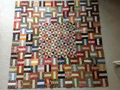 This is my table quilt made from Edyta Sitar's (Laundry Basket Quilts) ice cream sandwich blocks and leftover 1/2 square triangles from my pieced summer block of the week quilt from Lisa Bongean (Primitive Gatherings).  Love it!  Thanks to Edyta and Lisa for their continued inspiration!!!!
