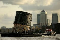 "Real(Mislabeled) -  Pinned as: ""A funnel from the RMS Titanic being towed on the Hudson into New York.""  -This is a ""replica"" of the upper section of the fourth funnel of the Titanic is towed along the river Thames towards Canary Wharf on November 3, 2010 in London, England. The replica funnel has been created to launch a new exhibition of artefacts recovered from the wreck of the Titanic cruise liner which sunk in the North Atlantic on April 15, 1912. (Photo by Oli Scarff/Getty Images)"