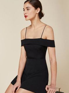 Shoulder season again. This is a fit and flare dress with a cold shoulder, straight neckline and adjustable straps.