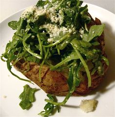 Kitchen Fiddler: Arugula-Stuffed Baked Potatoes  Veganize by using vegan parmasean and a vinaigrette without egg