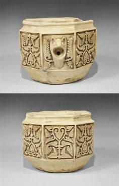Spain, probably Cordoba, 10th-11th century AD. A carved marble water basin, octagonal in plan with scooped recess beneath the rim, circular recess with drainage hole; the outer faces each with a carved foliage panel, one with animal-head spout.