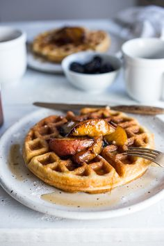 Crisp and light, Sourdough Waffles are delicious and SO simple to make using your extra sourdough starter. Top with delicious maple-glazed peaches or stone fruit. Scones, Vegetarian Brunch, French Toast Muffins, Sandwiches, Strawberry Rhubarb Crisp, Breakfast Dishes, Breakfast Recipes, Breakfast Ideas, Gastronomia