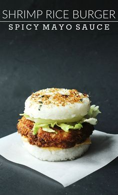 Crispy fried shrimp rice burger with delicious spicy mayo sauce! Add lettuce and onions for some freshness, and top with Furikake Japanese seasoning. Great Asian fusion recipe!