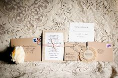 uses a page from a favorite book as a backdrop for invitation - doily has wedding website on it - love the brown paper and romantic simplicity!!