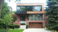 Renovated Toronto home with custom exterior accents made from real natural wood that has been thermally modified to provide natural beauty and curb appeal. #curbappeal  #landscape  #toronto  #garage  #wood  #doors  #trim  #renovation  #builders  #sheldrakeblvd  #homeowners  #house  #soffit  #decking  #siding  #naturalwood  #facade  #greenbuilding  #leed  #fsc  #cfpwoods  #construction