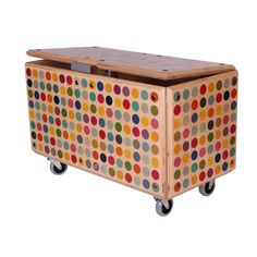Awesome chest for kids toys.  This made me think of you  clean lines of same size circles, cool colors yeah!