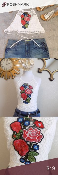 Rose Halter Tie Lace Top New  in the package. Embroidered floral design. Lace on the front. Has thin lining to cover bust. In my opinion this runs small.  Tag is size Medium. If you are a Medium  and not busty this might fit fine. Will fit better on XS and Small frame. 100% Polyester  My dress form size is Bust 34, W 26. Just to give you an idea on the approximate measurements.  Please measure before buying. Thanks! Tops Crop Tops