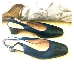"""HP FERRAGAMO SHOES CapToe Slingback Heels  Elegant FERRAGAMO Shoes with navy blue leather Slingback body and black patent leather cap toe.  Perfect shoes with classy 2"""" heel. Leather and shoe supple and like new. Must have for work and occasions.  I bought from FERRAGAMO NYC store on 5th Ave. I'm clearing my shoe collection. These are like brand new and worn all but a few times to events.  Size 8 M  or 8B. Ferragamo Shoes"""