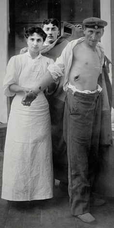 World War I wounded German soldier with nurse.