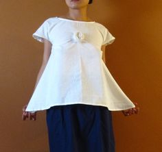 custom  white wavy top with pleated flower custom order listing. $80.00, via Etsy.
