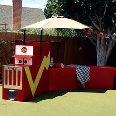 """""""Mack"""" (Disney Cars) hauled a truck load of food & libations:) The table was made out of UHaul boxes"""
