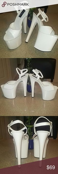 """8"""" Highest heel collection platform stelletoes   All white 8"""" stelletoes with a 3.75"""" platform BRAND NEW IN THE BOX NEVER WORN...! Very sexy and beautiful pair of stelletoes.  Highest Heel Collection Shoes Platforms"""