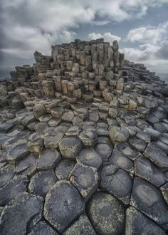stones stone rock rocks hegagon hexagonal ireland uk british scenery atmospheric dawn morning travel europe pattern shape composition traveling causeway giant giants blaminsky sunny clouds sky shae shapes