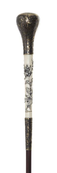 An American Silver and Japanese Ivory Handled Ladys Walking Stick, Length of handle 2 3/4 x length overall 35 1/2 inches.
