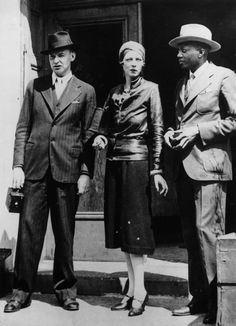 1932: Poet, publisher rebel and activist Nancy Cunard in Harlem, New York, with artist John Banting (1902 - 1972) and novelist Taylor Gordon (1893 - 1971, right). She is known to have taken an active stand against racial segregation in America. (Caption and photo courtesy of LIFE.com)