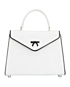 JOAN THE BELGIAN BAG from Hayden Lasher features white Italian crocodile embossed leather with black patent piping, signature bow detail, and nickel hardware.