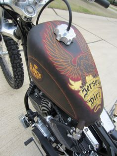Painted tank on bobber motorcycle