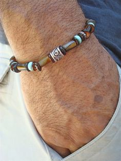 Mens Bracelet with Tigers Eye and Turquoise are alternated with Shell and Bali Beads. Very elegant bracelet fits a wrist of 7 1/2 to 8 1/2 inches since it has been beaded with high quality elastic cord. Let us know if we should adjust it to your wrist size. You can measure your wrist with a string and then measure the string with a ruler.
