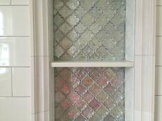 Niche in shower White subway tile, light grey grout, metallic arabesque tile