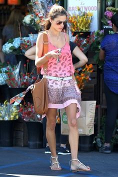 Alessandra Ambrosio wearing Hermes Soleil Evelyne PM Shoulder Bag and Hermes Belt.
