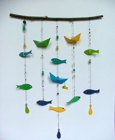 fun fish mobile made of paint chips Paint Chip Mobile, Paint Chip Art, Paint Chips, Fish Mobile, Baby Mobile, Diy Wall Art, Diy Art, Paper Mobile, Oragami Mobile