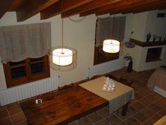 el menjador... la taula és de l'Antiga de Ripoll Totes les cortines me les va fer la meva mare El joc de cafè és regal de la Montse i en Lluís