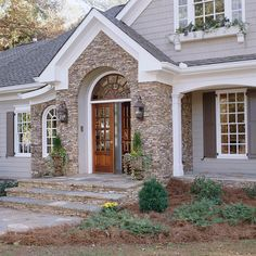 Repeat Elements - Connect the entry with the rest of your home's exterior by repeating elements that create a cohesive look. A prominent design element, such as the arch in the window above the double doors, reappears in the windows to the left of the entry Exterior Paint Colors, Exterior Design, Vinyl Siding Colors, Front Entry, Front Doors, Double Doors Entryway, Stone Houses, Houses With Stone Exterior, House Front
