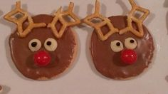 Rudolph biscuits! I used a plain Marie biscuit with choc icing, Jaffa nose, white choc buds for eyes, black icing pen for eyeballs, pretzels for antlers! Easy! For more ideas, find me on Facebook: Yibba Yabba Mama