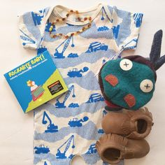 #romper #construction #bulldozer #blue #amberbeads #teethingnecklace #moccasins #brown #comfy #puppet #rockabyebaby #lullaby