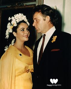 Best Celebrity Wedding Dress: Elizabeth Taylor (Again)  Two of Liz's marriages were to the same man, actor Richard Burton. For the first, the bride wore this unexpected yellow chiffon number with long, flowing sleeves, which she paired with a matching bouquet and an amazing headpiece of lilies of the valley and white hyacinths. #HappyHoneymoon