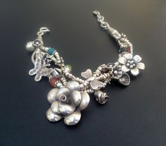 Handmade Sterling Silver and Ceramic Bead Charm by fishsilver