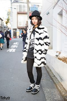 Electrical engineer Lana on the street in Harajuku wearing a Murua faux fur coat over an Adidas tee, Cecil McBee skinny jeans, and Bubbles Harajuku ankle boots.