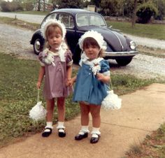 this could be my sister & I (my brother came later) - we always wore identically styled Easter dresses, in different colors, usually made by our mama. And we always got a new pocketbook for Easter. Yes, this could definitely be us - right down to the black VW that our family had when we were this age.