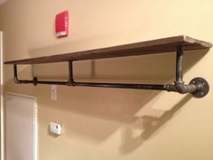 Industrial Pipe Wood Shelving - wondering if I can make this myself as a clothing rack...