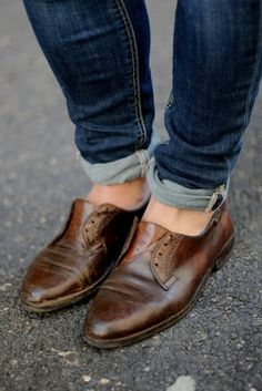 i like the rolled up skinny jeans with the manly shoes. (brown leather shoes)