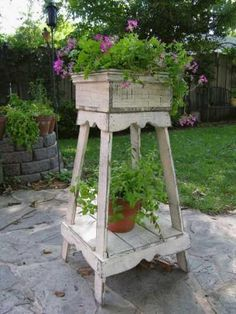 Be creative when it comes to container gardening.  By roaming through your local thrift store you will find treasures to use for container gardening.  Here is an old wooden plant stand and a wooden crate filled with plants.  A great treasure for your patio.  Photo: purplehearthouse.com