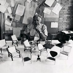 Hans J. Wegner with models of the chairs he designed.