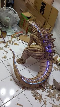 The guy who made the cardboard Godzilla added LED lights on its back!