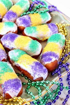 Mini Long Johns for Mardi Gras - oh heck make life simple use a twinkie and frost it and sprinkle with the colors!!