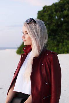 Ways to wear a statement cherry red Leather Biker Jacket, wearing a beautiful lambskin cherry jacket from Maje in the Maldives Kihavah